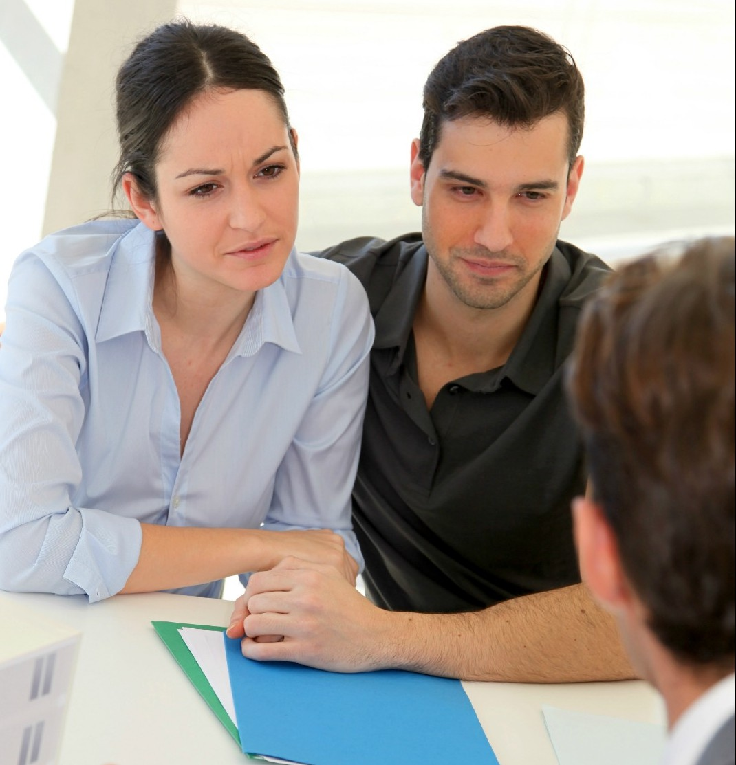 couple-discussing-with-a-real-estate-agent